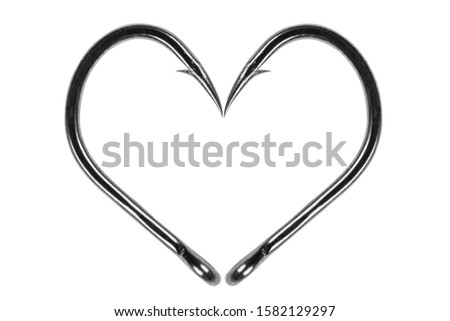 Fishing hook love heart sign isolated on a white background. Fishing hook close up. Fishing tackle. Stainless steel hooks. Fish hooks in heart shape. The concept of love of fishing.