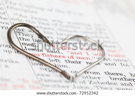 Fishing hooks on the Bible with focus on a very popular text in Matthew 4:19 where Jesus calls disciples to be fishers of men. All copyright items have been deleted.