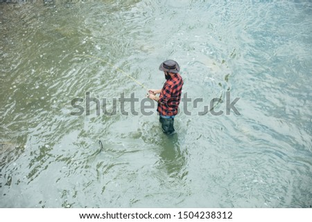 Fishing in river. Fly fishing for trout. Fishing. Fishing became a popular recreational activity #1504238312