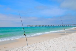 Fishing in the Gulf of Mexico, Panama City, FL, USA.  Pier stretching out into the ocean.