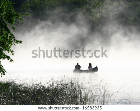 Fishing in the morning fog on the lake in Minnesota