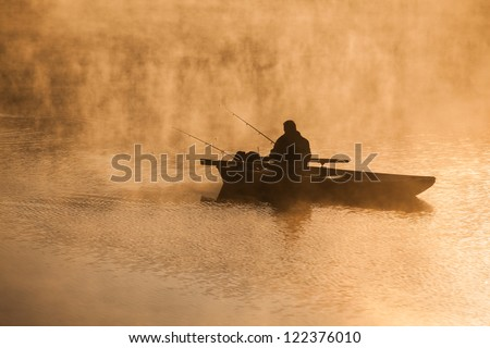 Fishing in the morning mist