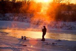 Fishing in the winter on not frozen reservoir