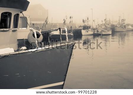 fishing industry, trawler or fishing boat in danish harbour - stock photo