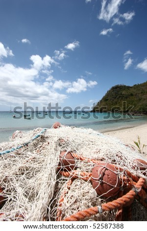 Fishing net and tropical beach background (Martinique Island -  French Antilles)
