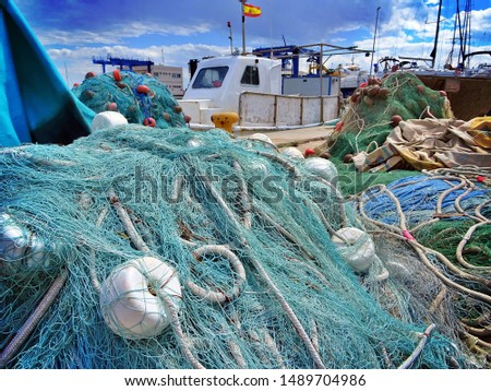 fishing net drying in the sun over the Santa Pola harbor in Alicante