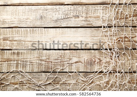 Fishing net on brown wooden table