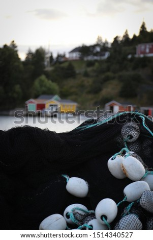 Fishing net, pile of nets and buoys stacked up in Dildo, Newdoundland