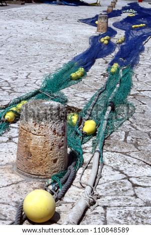 Fishing nets drying in the sun #110848589