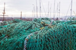 Fishing nets in a box on the edge of the harbour