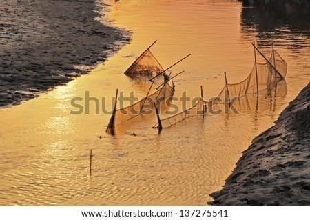 Fishing nets in the beautiful sunset #137275541