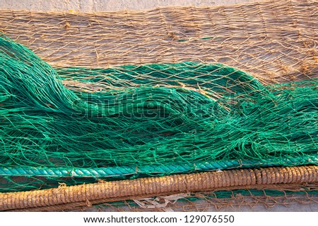 fishing nets texture pattern over soil in green and beige colors