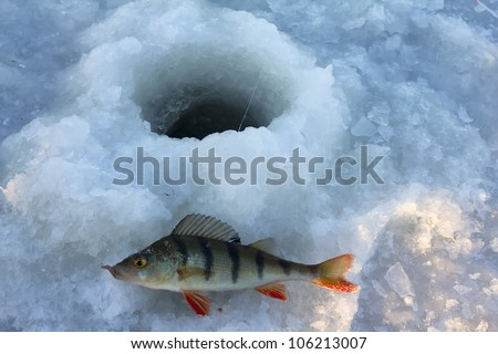 Fishing on lake in -15 degrees Celsius, 5 (F) Fahrenheit - stock photo