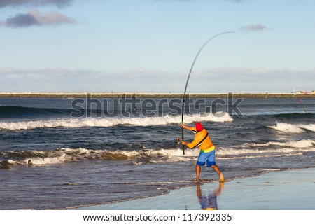 Fishing on the beach in Durban, South Africa.