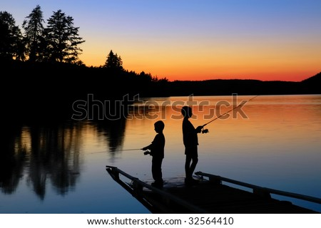 Fishing on the Dock at Sunset - stock photo