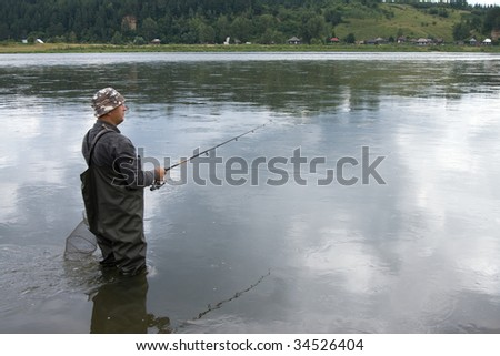Fishing on the mountain river with fast current #34526404