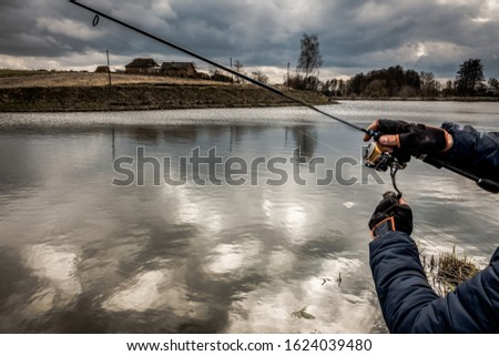 Fishing outdoor recreation on lake background