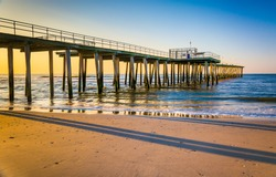 Fishing pier and the Atlantic Ocean at sunrise in Ventnor City, New Jersey.