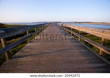 Fishing pier at dawn with disappearing perspective