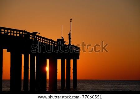 fishing pier at sunrise st. augustine beach florida usa