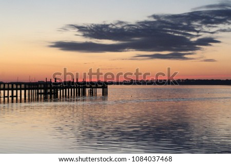 Fishing pier jetty silhouette with sunset sky #1084037468