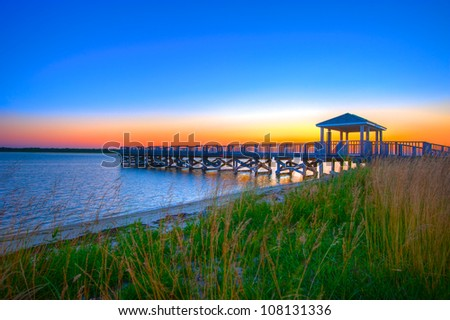 Fishing Pier Silhouette Against a Colorful Dawn Sky.