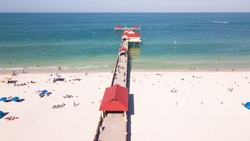 Fishing pier. Spring break or summer vacations. Ocean or Gulf of Mexico turquoise saltwater. Clearwater Beach Florida pier 60.