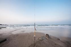 fishing pole on the beach