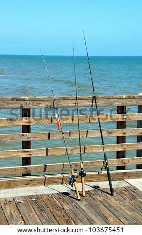 Fishing poles on an ocean pier, Florida,USA.