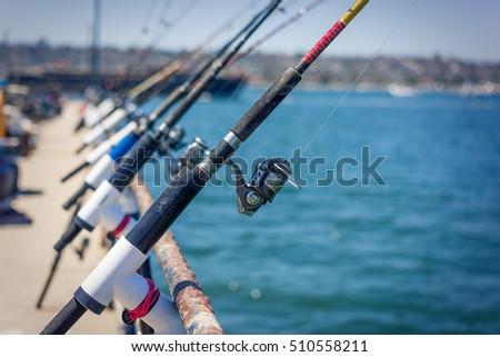 Fishing Polls in a Row on Pier in San Diego Bay, California.