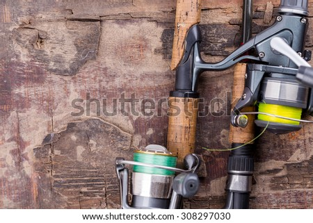 fishing rod and reel with line on natural background for frame, print, design