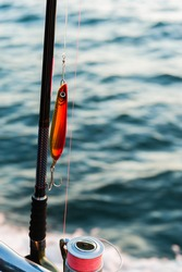 Fishing rod details with spinning wheel.