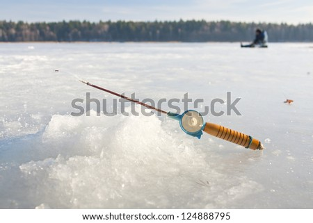 Fishing rod for winter fishing is on the ice #124888795