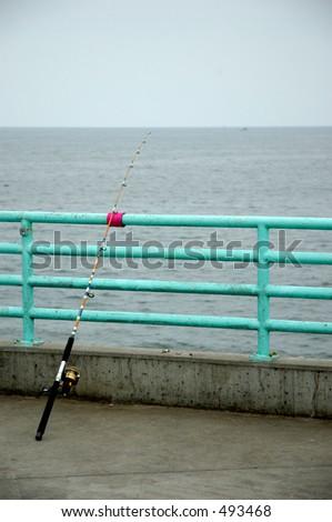 Fishing rod on pier.