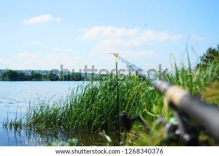 fishing rod, rod, spinning, feeder, fishing, fishing rod with fishing line on the background of water #1268340376