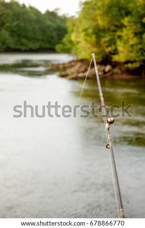 Fishing Rod (Selective Focus) at estuary #678866770