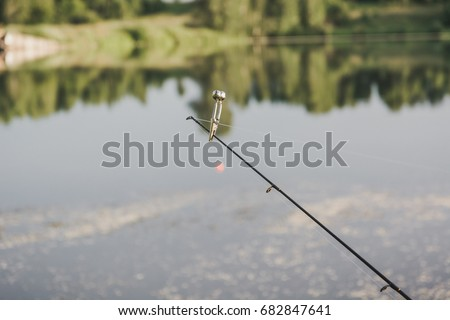 Fishing. Rod tip. To fish a rod. Spinning. Fishing by a spinning #682847641