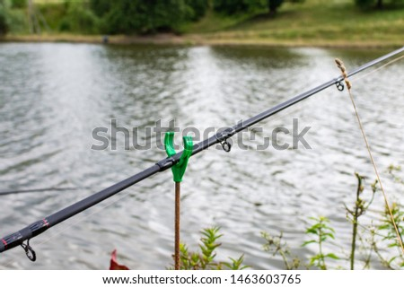 Fishing rod with a bell in the water, fishing in summer #1463603765