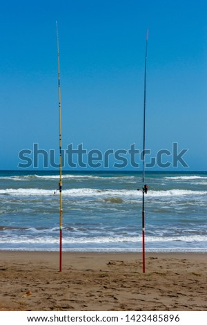 fishing rods waiting on the beach of the Trabucador delta del Ebro #1423485896