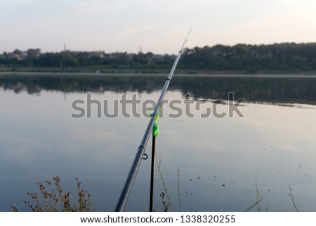 Fishing rods with reels on a support system rod pod. Carp fishing rods #1338320255
