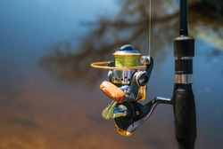 fishing rods with spinning and reel of a fisherman