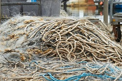 Fishing ropes and nets, no longer used on Poole quay, signs of a declining fishing industry