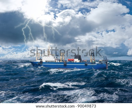 Fishing ship in strong storm sea