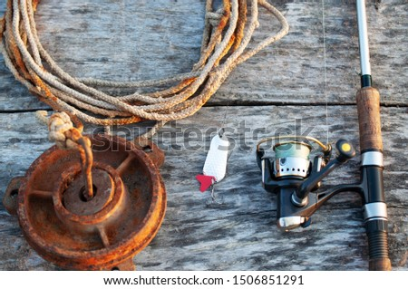 fishing tackle and accessories on wooden table #1506851291