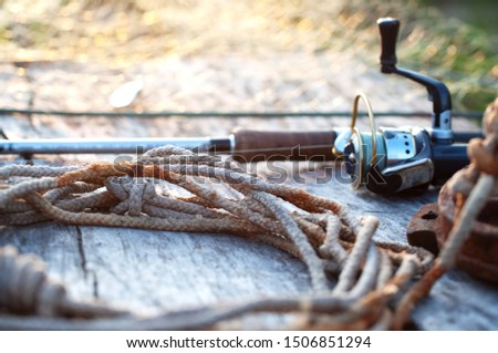fishing tackle and accessories on wooden table #1506851294