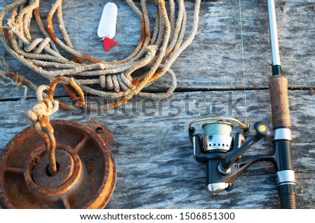 fishing tackle and accessories on wooden table #1506851300