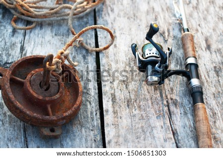 fishing tackle and accessories on wooden table #1506851303