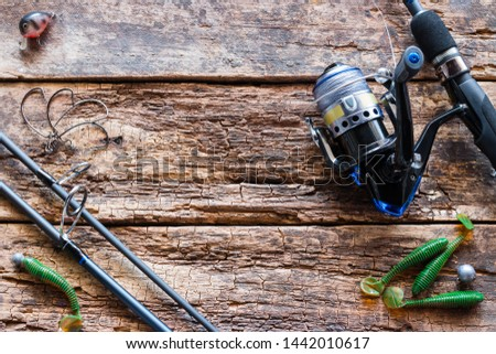 fishing tackle and bait on wooden background #1442010617