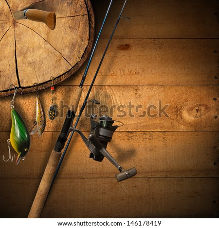 Fishing Tackle Background / Wooden background with fishing tackle and knife