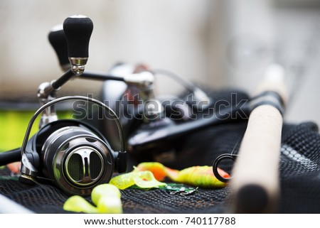 Fishing tackle - fishing spinning, fishing reel isolated #740117788